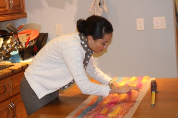 A workshop participant laying out her beautiful scarf