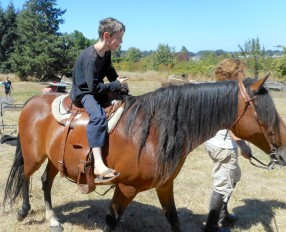 Jonah gets a ride on Honey with me leading
