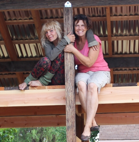 My sister and I on the loft of the little barn after putting the roof on