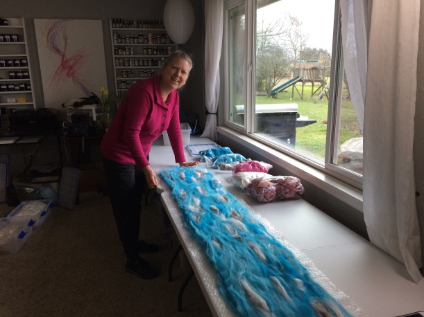 Jennie laying out her scarf at a workshop