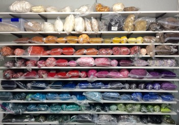 My rainbow wall of Merino wool fiber colors for felting