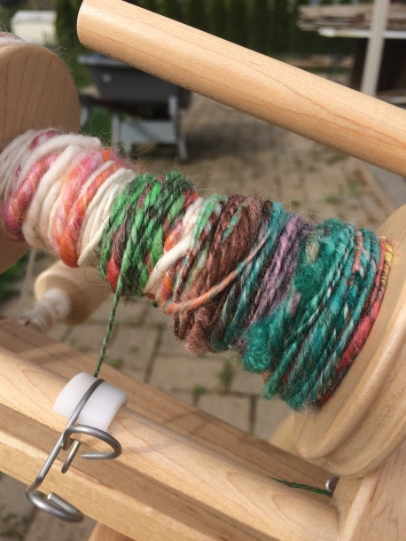 Some of the colorful art yarn on the spindle