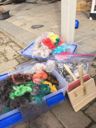 The wool I'm carding and spinning into colorful art yarn