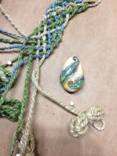 Creating a necklace with spun wool and silk to go with the lamp work focal bead