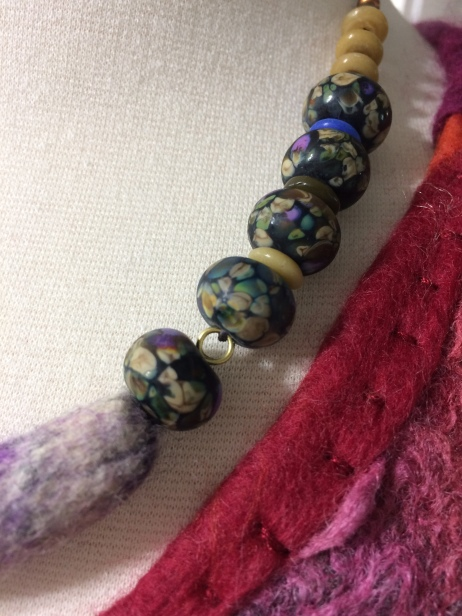 Necklace with lamp work beads and felted center bead